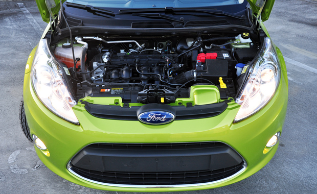 The Fiesta engine bay featuring a 1.6L DOHC 4 cylinder engine with VCT