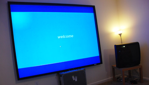 Projector screen showing Windows XP booting