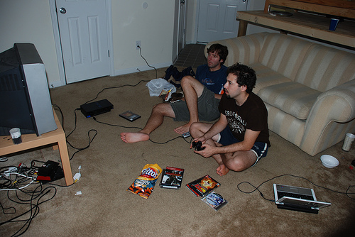 Living room and roommates playing PS2