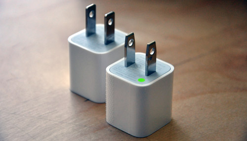 Front: New Apple power adapter, Back: Recalled adapter