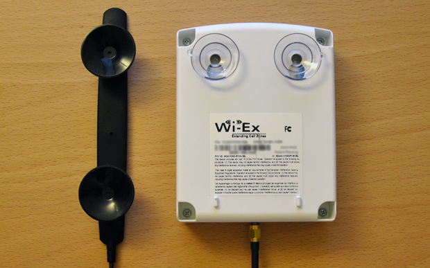 The Wi-Ex zBoost zPersonal YX300 unit and booster antenna