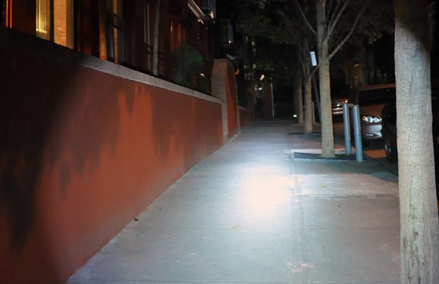 Neofab Legion II flashlight lighting up a sidewalk