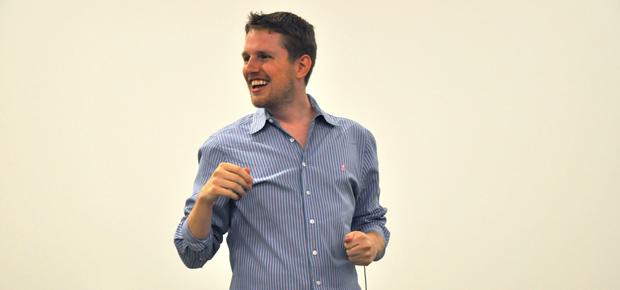 Matt Mullenweg holding a WordPress/WordCamp Town Hall
