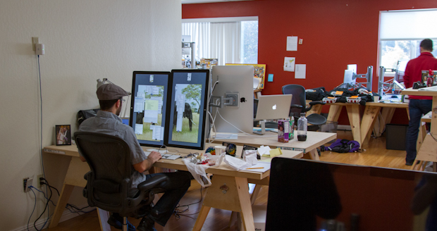 Erik Rose working with this dual vertical Apple Cinema Displays